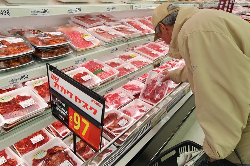 A customer browses packaged beef at a Seiyu GK supermarket in Tokyo, Japan.