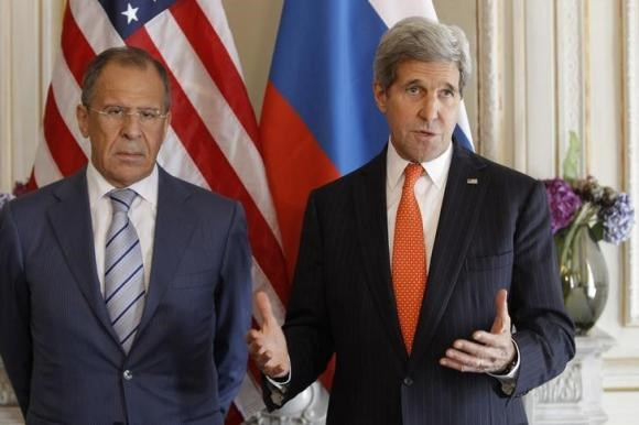 U.S. Secretary of State John Kerry (R) gestures as he stands with his Russian counterpart Sergey Lavrov, before their meeting in Paris, June 5, 2014. Both are in France for the 70th anniversary of the Normandy landings.
