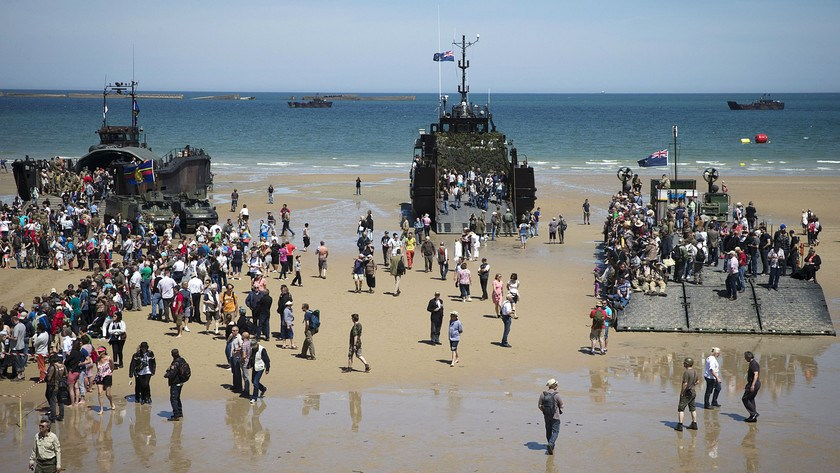 People visit World War II landing crafts on the Arromanches beach, Normandy, on June 6, 2014, during the ceremonies marking the 70th anniversary of Operation Overlord. Photo credit: AFP