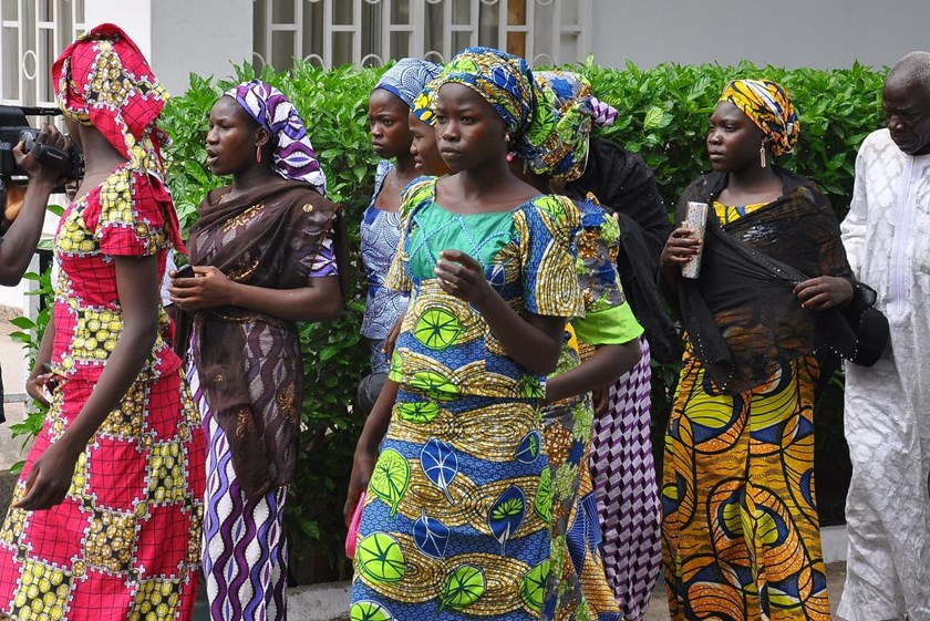 Schoolgirls who escaped from Boko Haram kidnappers in the village of Chibok, some of more than 200 kidnapped girls, arrive at the Government house to speak with Borno state governor Kashim Shettima in Maiduguri, Nigeria, on June 2, 2014. Photo credit: AFP