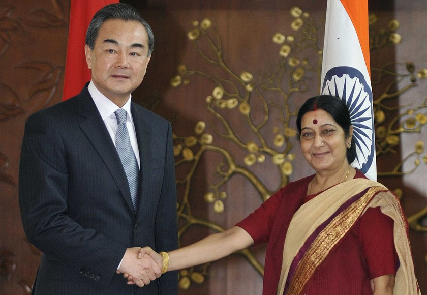 Foreign Minister Sushma Swaraj, right, and her Chinese counterpart Wang Yi shake hands before a meeting in New Delhi, India, on June 8, 2014.