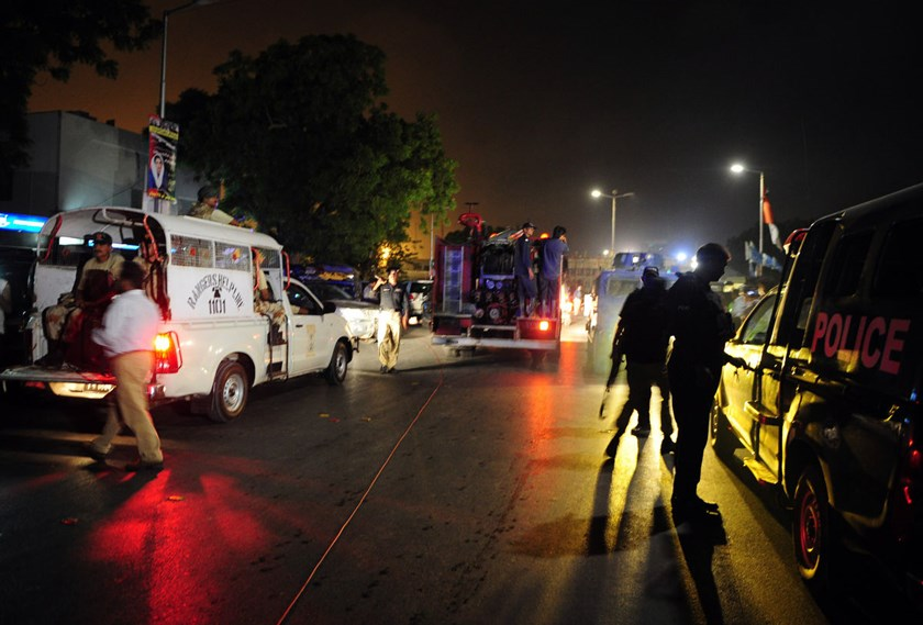 Pakistani security personnel gather outside the Jinnah International Airport in Karachi after an assault by gunmen, late on June 8, 2014. Photo credit: AFP