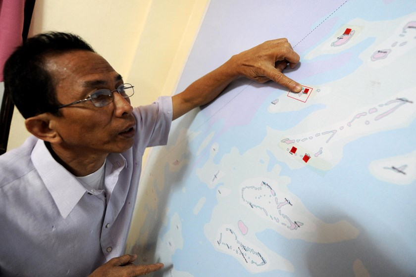 "Eugenio Bito-onon, mayor of the Kalayaan Ilands, points to a map showing the island of Kalayaan, which means ""Freedom"" in Filipino. Photo credit: AFP/Getty Images"