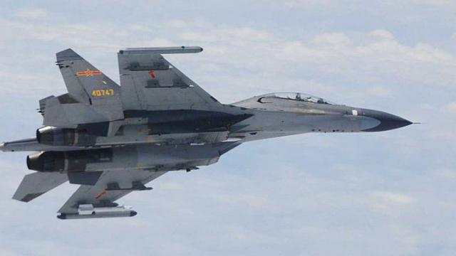 Japan says Chinese fighter jets flew near its planes again