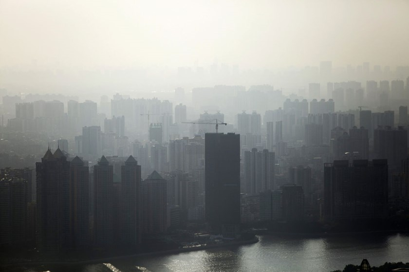 Haze surrounds residential buildings in Guangzhou, China. A 22 percent drop in the construction of new buildings in the first four months of 2014 highlighted the potential for property to drag down an economy projected to grow 7.3 percent this year, the s