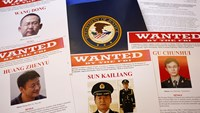 Press materials are displayed on a table of the Justice Department in Washington, Monday, May 19, 2014, before Attorney General Eric Holder was to speak at a news conference.