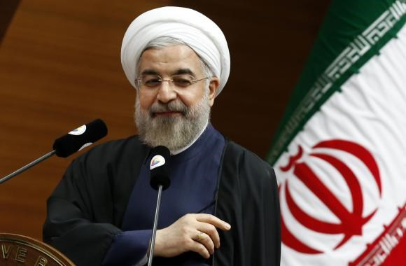 Iran's President Hassan Rouhani addresses the audience during a meeting in Ankara June 10, 2014.