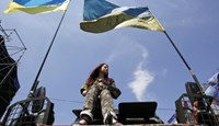 In Ukraine, a day of mourning shows nation divided