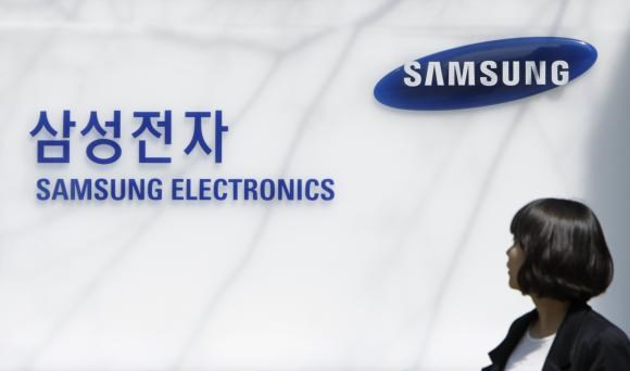 An employee of Samsung Electronics walks past the company main office in Seoul in this April 6, 2010 file photo.