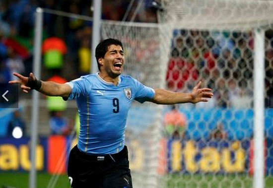 Uruguay's Luis Suarez celebrates after scoring his 2nd goal during the 2014 World Cup Group D soccer match between Uruguay and England at the Corinthians arena in Sao Paulo June 19, 2014.