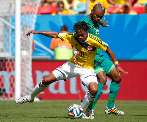 Colombia's Juan Cuadrado is challenged by Ivory Coast's Geoffroy Serey Die.