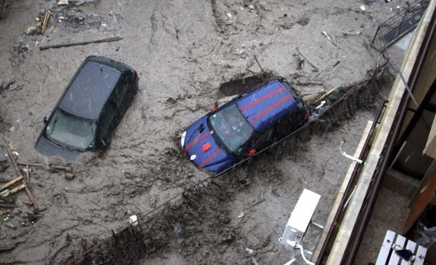 Partially-submerged cars are pictured during heavy flooding in the city of Varna, in northeastern Bulgaria, June 19, 2014.