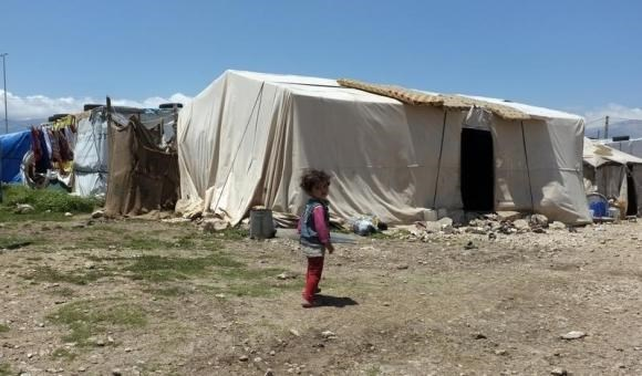 A Syrian girl stands in a refugee camp in the east Lebanese town of Anjar near the Syrian border May 13, 2014.