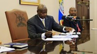 Uganda's President Yoweri Museveni signs an anti-homosexual bill into law at the state house in Entebbe, 36 km (22 miles) southwest of the capital Kampala February 24, 2014.