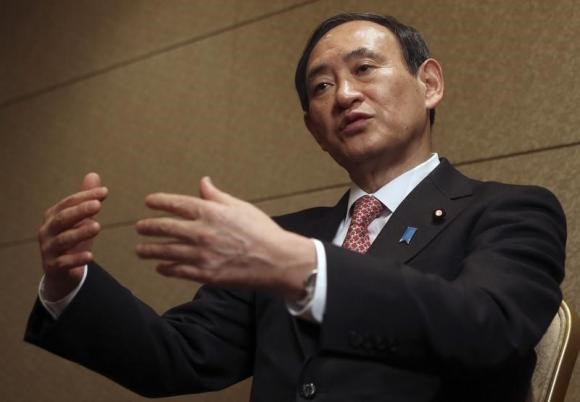 Japan's Chief Cabinet Secretary Yoshihide Suga speaks during an interview with Reuters in Tokyo February 15, 2014.