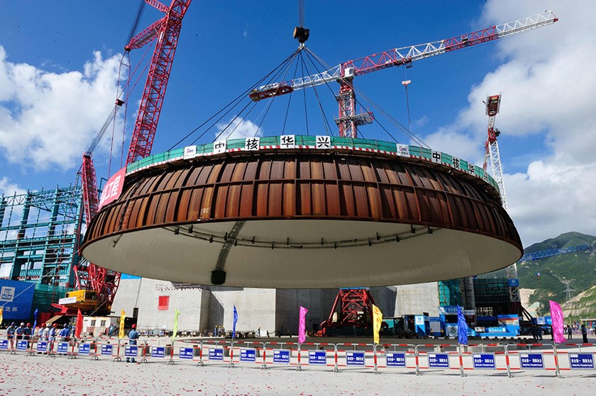 The dome of a containment structure is being hoisted at the Taishan Unit 2 Nuclear Power Plant in Taishan, China. Photograph: Imaginechina via AP Images