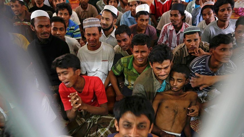 Rohingya people from Myanmar, who were rescued from human traffickers, react from inside a communal cell at Songkhla Immigration Detention Centre where they are kept near Thailand's border with Malaysia on Feb. 12.