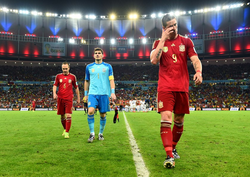 Andres Iniesta, Iker Casillas and Fernando Torres of Spain walk off the pitch after the 2014 FIFA World Cup Brazil Group B match between Spain and Chile at Estadio Maracana on June 18, 2014.