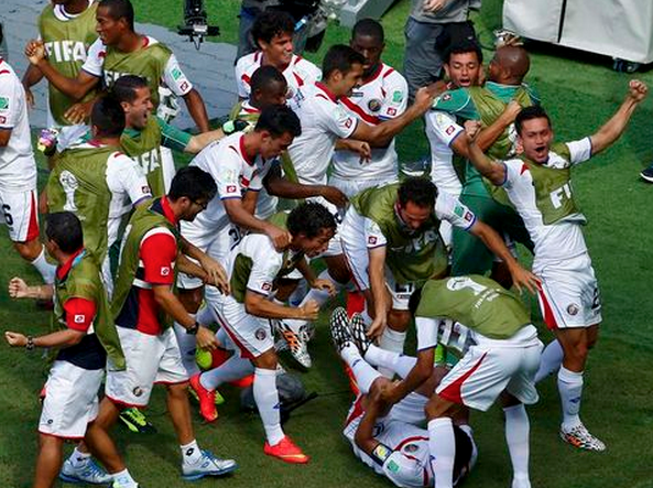 Costa Rica's players celebrate after their teammate Bryan Ruiz (on the ground) scored a goal against Italy during their 2014 World Cup Group D soccer match at the Pernambuco arena in Recife June 20, 2014.
