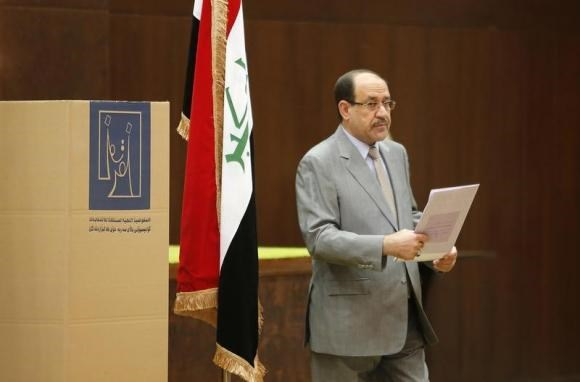 Iraq's Prime Minister Nuri al-Maliki prepares to vote during parliamentary election in Baghdad April 30, 2014.