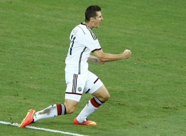 Germany's Miroslav Klose celebrates his goal during their 2014 World Cup Group G soccer match against Ghana at the Castelao arena in Fortaleza June 21, 2014.