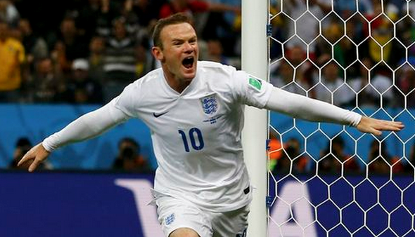 England's Wayne Rooney celebrates scoring against Uruguay during their 2014 World Cup Group D soccer match at the Corinthians arena in Sao Paulo June 19, 2014.