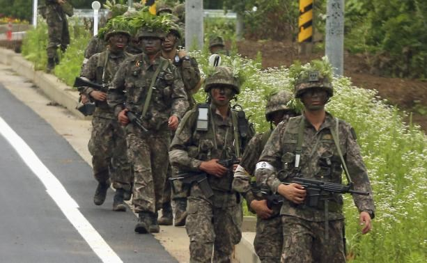 South Korea conscript who killed five comrades continues standoff with troops