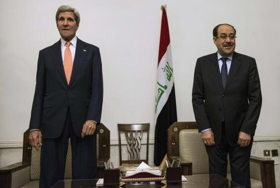 Iraqi Prime Minister Nuri al-Maliki (R) and U.S. Secretary of State John Kerry meet at the Prime Minister's Office in Baghdad June 23, 2014.