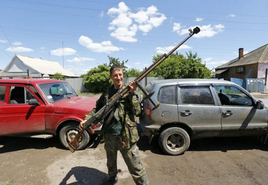 A pro-Russian separatist shows a World War 2-era anti-tank rifle in Seversk (Siversk), Donetsk region June 22, 2014.