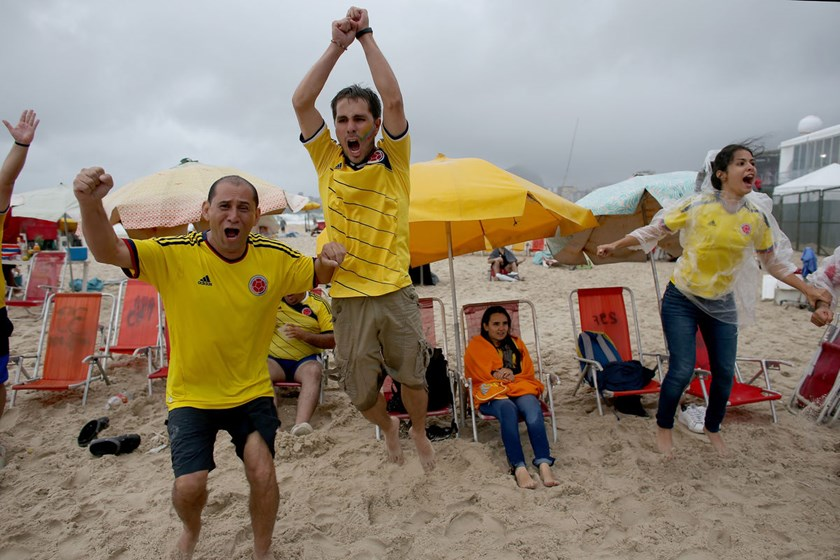 Colombian soccer team fans react as they watch their team score their second goal against Ivory Coast on a screen at the World Cup FIFA Fan Fest on Copacabana beach in Rio de Janeiro, Brazil.