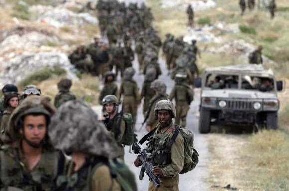 Israeli soldiers take part in an operation to locate three Israeli teens near the West Bank City of Hebron June 21, 2014.