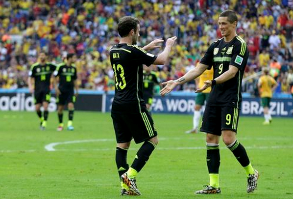 Spain's Juan Mata celebrates with Fernando Torres (9) after scoring a goal during the 2014 World Cup Group B soccer match between Australia and Spain at the Baixada arena in Curitiba June 23, 2014.