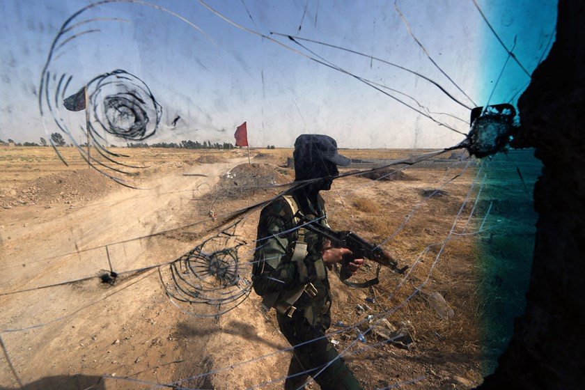 Iraqi Turkmen forces patrol a checkpoint in the northern city of Tuz Khurmatu, close to locations of the Islamic State in Iraq and the Levant fighters, on June 21, 2014.