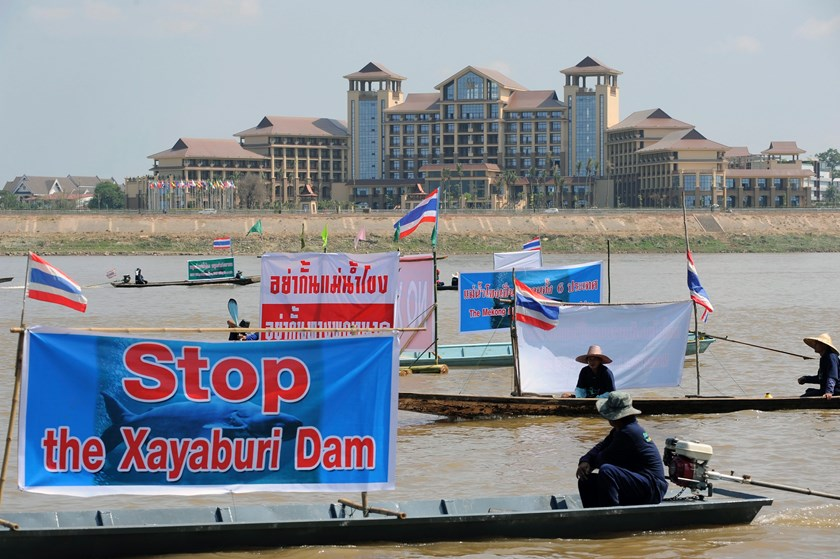 Laotian territory provides a backdrop as Thai activists and villagers affected by the controversial Xayaburi dam express their opposition on the Mekong River in Nong Khai province in a file photo taken in 2012. Photo: European Pressphoto Agency / The Netw