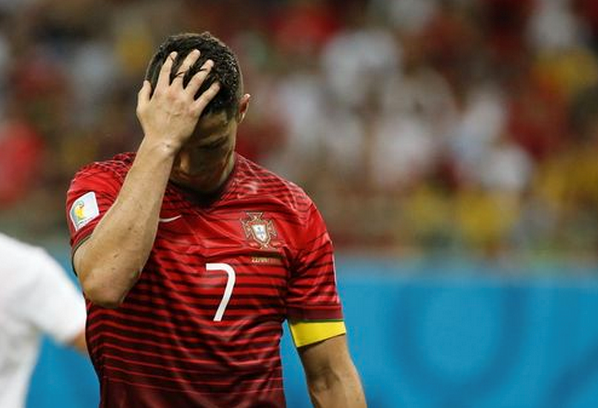Portugal's Cristiano Ronaldo reacts after missing a chance to score against the U.S. during their 2014 World Cup Group G soccer match at the Amazonia arena in Manaus June 22, 2014.
