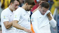 England's Phil Jones ,Steven Gerrard and Wayne Rooney react after the match against Costa Rica during their 2014 World Cup Group D soccer match at the Mineirao stadium in Belo Horizonte June 24, 2014.