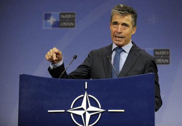 NATO Secretary General Anders Fogh Rasmussen addresses a news conference during a NATO defence ministers meeting at the Alliance headquarters in Brussels June 4, 2014.