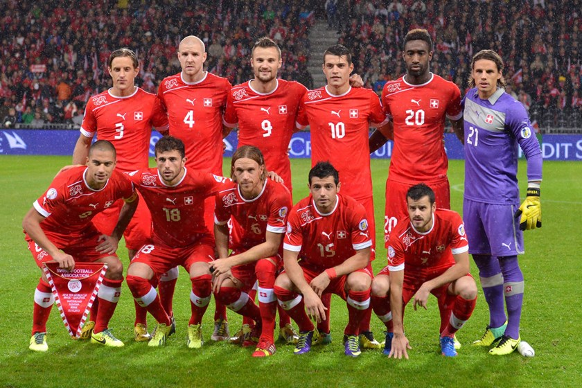 Members of Switzerland's World Cup team pose for a photo prior to a match between Switzerland and Slovenia at Stade de Suisse in Bern, Switzerland, on Oct. 15, 2013.