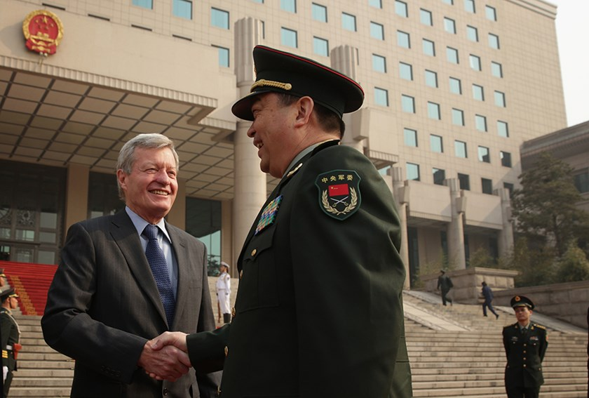 Chinese Minister of Defense Chang Wanquan (R) shakes hands with U.S. Ambassador to China Max Baucus (L) during a ceremony to welcome U.S. Secretary of Defense Chuck Hagel at the Chinese Defense Ministry headquarters April 8, 2014 in Beijing, China.