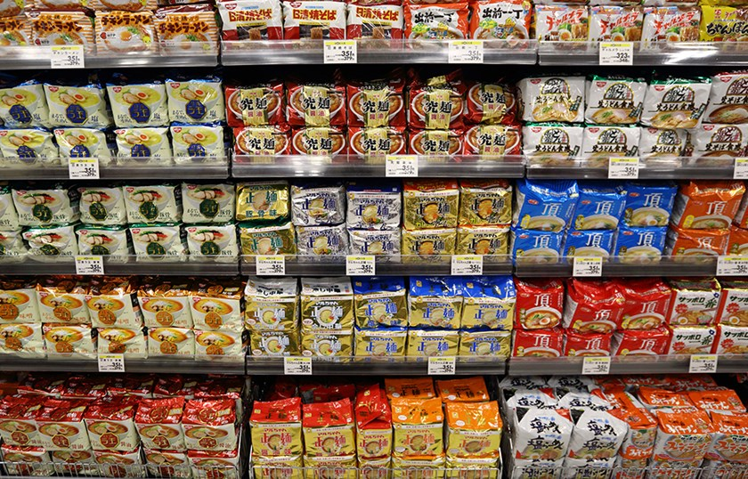 Bags of instant noodles are displayed for sale at a supermarket in Chiba, Japan.