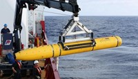 Crew aboard the Australian Defence Vessel Ocean Shield move the U.S. Navy's Bluefin-21 autonomous underwater vehicle into position for deployment in the southern Indian Ocean to look for the missing Malaysia Airlines flight MH370, April 14, 2014 in this h