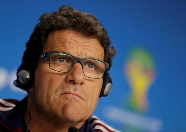 Russia's national soccer team coach Fabio Capello attends a news conference at the Arena Baixada soccer stadium, a day before the team's match against Algeria, in Curitiba June 25, 2014.
