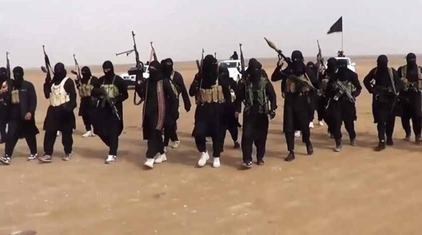 An image grab taken from a propaganda video uploaded on June 11, 2014 by jihadist group the Islamic State of Iraq and the Levant (ISIL) allegedly shows ISIL militants gathering at an undisclosed location in Iraq's Nineveh province