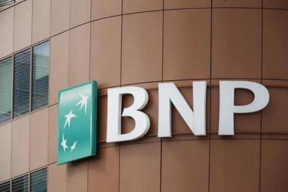 The logo of BNP Paribas is seen on top of the bank's building in Fontenay-sous-Bois, eastern Paris, May 30, 2014.