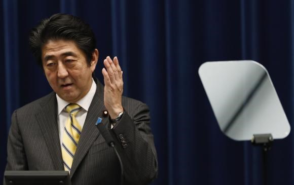 Japan's Prime Minister Shinzo Abe speaks next to a teleprompter during a news conference at his official residence in Tokyo June 24, 2014.