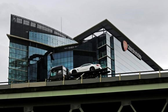 A car transporter drives past the office of pharmaceutical giant GlaxoSmithKline (GSK) in London April 22, 2014.