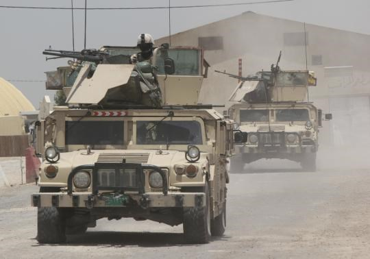 Iraqi security forces ride on vehicles during an intensive security deployment in the town of Jurf al-Sakhar, south of Baghdad,June 30, 2014.