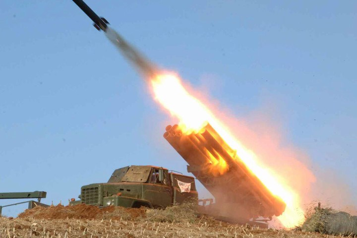 A photo released by a North Korean newspaper shows a North Korean military rocket launcher being fired. Photo credit: EPA