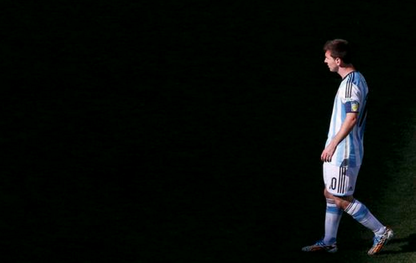 Argentina's Lionel Messi walks on the pitch during their 2014 World Cup round of 16 game against Switzerland at the Corinthians arena in Sao Paulo July 1, 2014.
