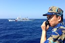 The captain of Vietnamese Coast Guard vessel No. 8003 is flanked by a Chinese Coast Guard ship, left, in disputed waters claimed by both China and Vietnam west of the Paracel islands, Vietnam, on May 15, 2014. China in early May towed a $1 billion oil exp